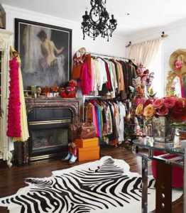 Rock AND roll. This boho glam dressing room is a great example of how opposites really do attract - mixing bright florals with a black chandelier and cowboy boots with frilly frocks.
