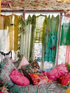 Flower-full from top to bottom. Hippie chic sheer dresses, bloomin' pillows and even a wallpapered garden on the ceiling.
